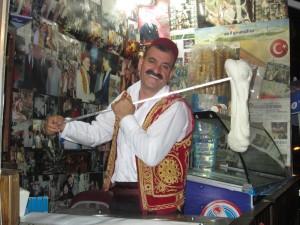 Man wearing a fez hat serving maras icecream in Turkey