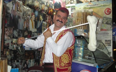 Man wearing a fez hat serving maras icecream in Turkey